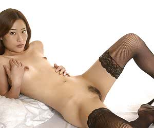 Tender Asian babe spreads her legs to show accurate intimate haircut