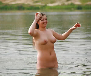 Fat nude mature ladies having fun in a water