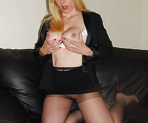 Blonde mature shows her shaved pussy