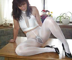 MILF in glossy white pantyhose spreads her legs on the kitchen for best view her hairy pussy
