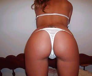 Ordinary girlfriends enjoying exposing their butts in thongs