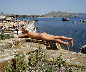 A busty babe getting it at the Santorini