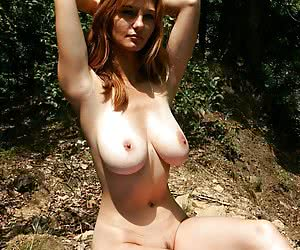 Busty MILG posing naked at the deserted place somewhere in the countryside