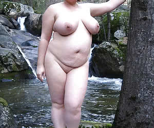 Fat nudist housewives posing outdoors