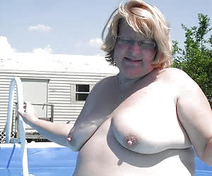 Mature nudist plumpers in a small private pools