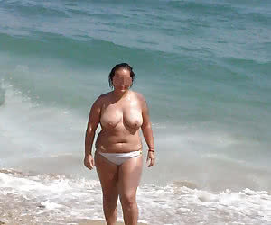 Older dames at sunny and sandy nudist beaches