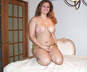 Chubby cutie posing on her bed galery