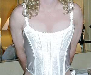 Crossdresser posing in beautiful lingerie gelery
