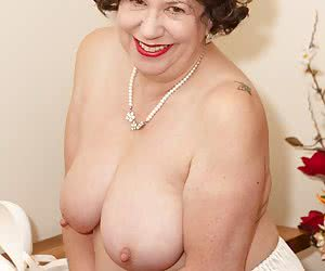 Hi Guys, Your Auntie Trisha didnt have time to finish getting ready for this hot photoset so we kick off with her in jus