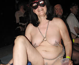 Older women partying weared in topless carnival clothes