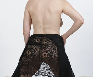 In a very fine dress of snares and trapsThe skirt slipped up again.Horny Posing and yet not too obvious.