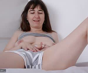 Posing in Gray panty outfit and a top.Soulful on the bed.