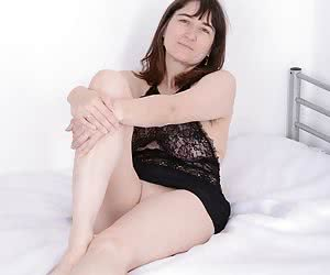 sometimes simply a gentle photoset.On the bed in fine lingerie set with lace and heels