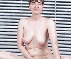 With blue Lingerie on the Bed.Of course not for long.Naked, I feel better.And proudly I present my shaved pussy.