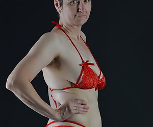 Yes as a Posing in Red Lingerie is already beautiful.But a Strip is still beautiful...
