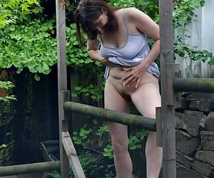 Yes in summer dress at the pond.I am much too hot.So down with it.Naked in nature but is Horny.