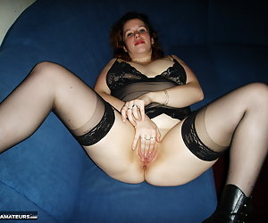 Amateur snapshot pictures of voluptuous big tits redhead Jessica posing in lingerie at home. Jessica spreads her legs wi