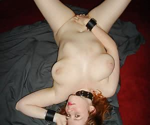 Amateur snapshot pictures of voluptuous big tits redhead Jessica.She is handcuffed, nude and only wearing black high hee