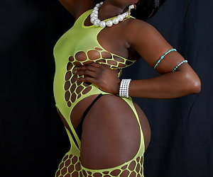 Ebony Petals, dark beauty is stripping down her sexy fishnet playsuit and panties.