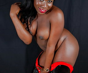 Ebony Petals, hot black goddess wearing high heel boots and stripping nude.