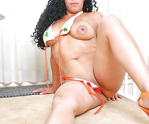 Hot Latina milf Serena strips off her bikini at home and starts masturbating with another of her sex toys.