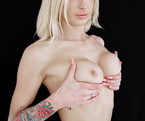 Mandy Slim is teasing in pink underwear, stripping nude and masturbating with a vibrator.