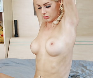 Mandy Slim playing with a vibrator in bed and inserting a little butt plug.