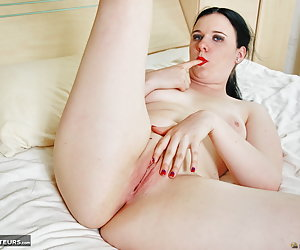 Mona Summers, horny young Dutch pornslut is stripping nude in the bedroom and spreading her legs and cunt lips.