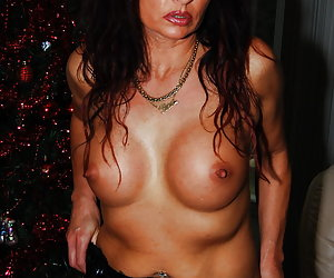 Natascha is doing some unwrapping striptease at the christmas tree.