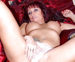 Natascha, topless russian milf is stripping down her panties and giving you a good look at her tight mature ass.