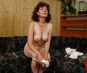 Old hot lady is undressing and posing