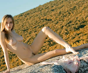 Young naturist girls posing in front of the nature