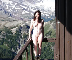 Young tall naturist girls in front of the mountains