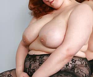 Fat redhead babe in a black fishnet