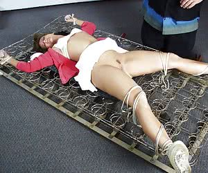 Pretty young brunette punished hard and painfully
