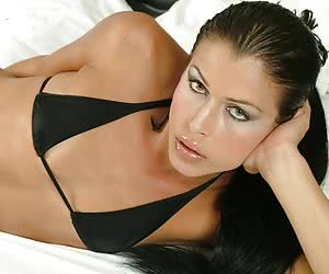 Tall transsexual model pulls down her seductive black underwear