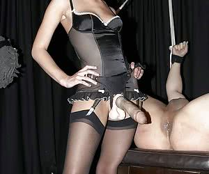 Innocent looking blonde Mistress penetrates male slave using a very big strap-on dildo very professional way