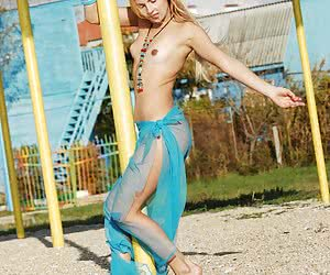 Barely legal blonde exposing every inch of her hot smooth body outdoor