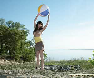 Big-breasted Ukrainian beauty undressing and spreading wide on the sand