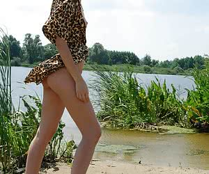 Sexy young babe luxuriating in the warm water and posing nude on camera