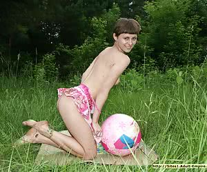 Slim barely legal teenie playing some nude game outdoor on the grass