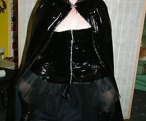 All dressed up as a 'black witch' in pvc and stockings. Hope this set gets you hard.