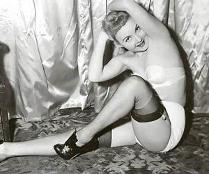 Excited females pose and enjoy showing their retro lingerie and juiciest spots of their bodies
