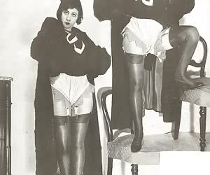 Neat female in dark clothes and retro lingerie loses control on showing her body in various poses