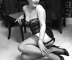 Several gals in very sexy retro lingerie get their rocks while posing and showing themselves