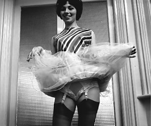 Sexy chick decides to raise the hem of her skirt in order to let you see her sexy vintage lingerie