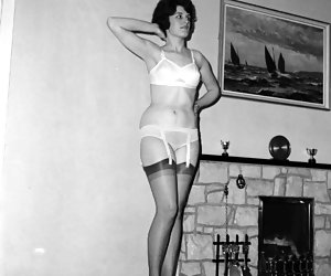 This time pretty chick poses in retro lingerie and changes her dresses from time to time