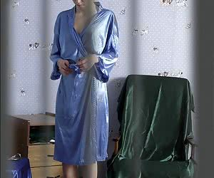 Home hidden camera took the photo of lovely doll while she was changing her robe and putting panties on