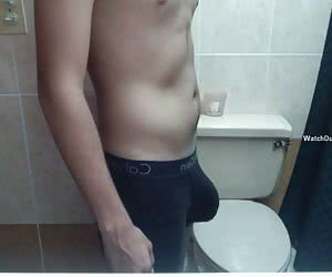 Cute and hot 18 y.o. guys showing off their dicks to camera at bathroom